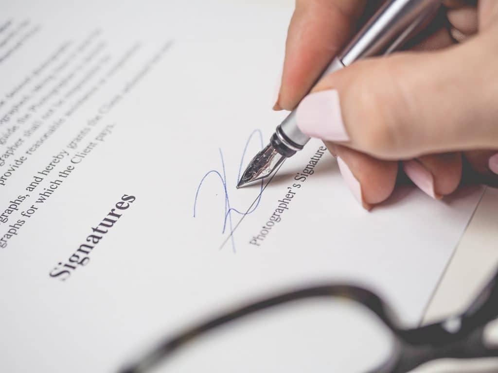 Person writing signature
